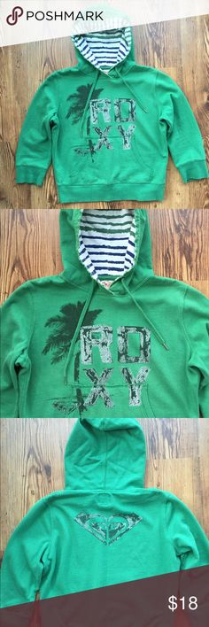 ROXY Hoodie with 3/4 sleeves ROXY vintage washed pullover hoodie in true green. Front pocket, contrast lined hood and ROXY logos on front and back. Super cute and in great condition! Roxy Tops Sweatshirts & Hoodies