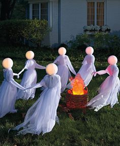 Want to really cause a scene? Treat the entire neighborhood to a circle of our lighted Set of Three Holding Hands Ghosts on your lawn—no one can miss their ominously glowing heads.