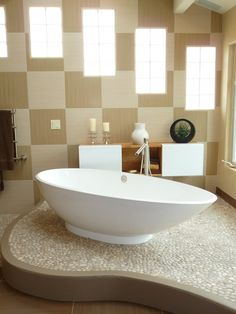 Love the raised floor the tub sits on and the tub design.