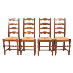Set of four vintage French country dining chairs with oak frames and rush seats.   Product: Set of 4 chairsConstructi...