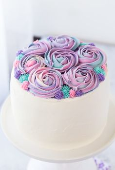 White chocolate rose cakewith hints of floral rose water and whipped white chocolate frosting.