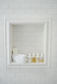 white subway tile bathroom | shower niche - white subway tile and chair rail trim | home.