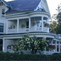 ooooooooh. gorgeous victorian house with double wraparound porches::
