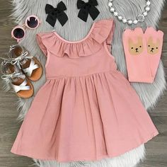 Looking for a cute stylish party dress for your toddler girl?  This pink blush pleated dress featuring ruffle collar is perfect for any party occassion.