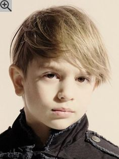 Trendy haircut for little boys. With short sides and long bangs that accentuate the eyes.