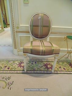 Lot 1002 - Louis XVI style single painted chair the round shaped upholstery seat over fluted tapered round