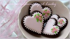 Valentine heart with rosettes decorated chocolate cut out sugar cookies...so pretty! #cookiedecorating