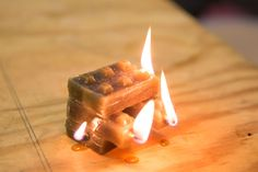 Make your own mold so that you can cast your own candles in any shape you'd like — these ones stack like Lego!