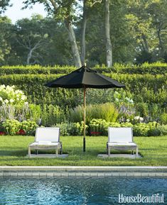 Poolside, a Walpole Outdoors umbrella is paired with lounge chairs from Crate & Barrel. Outdoor Areas, Outdoor Sofa, Outdoor Living, Outdoor Furniture Sets, Outdoor Decor, Walpole Outdoors, Pool Lounge Chairs, Bluestone Patio, Pool Houses