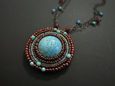 beaded embroidery pendant by amber leilani middleton, via Flickr