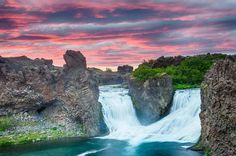 I love the double waterfall Hjalparfoss. The falls are located on the river…