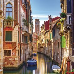 The gorgeous colours of the buildings surrounding the canals of Venice gleam in the Italian sunshine