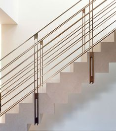 STAIRS: Sixteen Picks from DPAGES Files | Bronze stair railings in a luxury Melbourne residence by Carr Design Group.