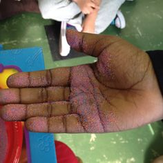 Learning how germs spread. Use colored hand sprinkle it on a child's hand and have them shake the hand of another. The colored sand will transfer to the other hand with ease showing how easy it is to spread germs. WashYourHands!!!!!!