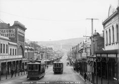 George Street, Dunedin showing shops and businesses on both sides of the street, including J & J Arthur Ltd in the left foreground. Two trams are a. Dunedin New Zealand, Auckland New Zealand, Old Photos, Vintage Photos, Long Gone, Back In Time, Historical Photos, Genealogy, Street View