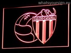 Calcio Catania - Neon sign LED display made of the best-quality transparent plastic and intense colorful LED illumination. The neon sign looks exactly the same from all angles thanks to the carving with the newest 3D laser engraving technology. This LED neon sign is a great gift idea! The neon is provided with a metal chain for displaying. Available in 3 sizes in following colours: Green, Yellow, Red, Orange, Blue, White and Purple!