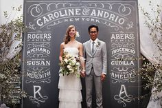 We keep seeing these amazing chalkboard and typography designs pop up at wedding receptions. What do you think of this photo backdrop? It creates a stunning scene for the bride and groom.