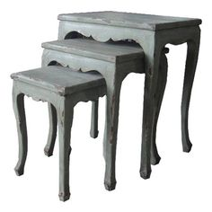 Three distressed wood nesting tables with scalloped aprons.   Product: Small, medium and large nesting tableConstruction M...