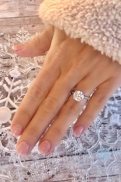 This classic 4-prong pave engagement ring featuring a thin band is the perfect way to highlight your center stone. This image features a stunning round diamond, but the setting can be paired with any diamond shape. Ring from Diamonds Direct. #engagementring #rounddiamond #diamond #thinband #pave #4prong #diamondsdirect