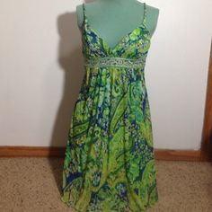 Cute Party Dress Cute little patterned party dress! Braised straps and flattering v neckline. In good condition! :) City Triangles Dresses
