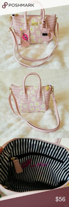 NWT Betsey Johnson satchel. Daisy & cat. NWT Betsey Johnson pastel pink satchel. Daisy pattern, bow tie cat tag, gold tone details. Removable and fully adjustable shoulder strap. Inner zipper pocket. Top zip. 7 inch height and 8 inch width. Betsey Johnson Bags Satchels