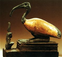 Thoth and Ma'at, Middle Kingdom, 300-200 BCE, bronze and gilded wood.