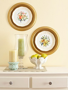 Use cheap ceiling medallions as frames for interesting plates. Easy!