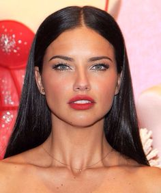 Adriana Lima. Love these red lips as well as the makeup look