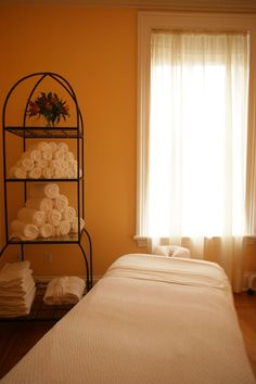 Would be connected with the pedi and mani area in a side room and the color of the walls would be changed and there would be 2 facial tables with a curtain separating them.