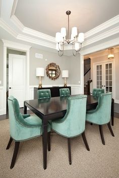 Gray dining room with aqua velvet chairs. Oakley Home Builders, Chicago, IL