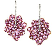 PAIR OF SAPPHIRE AND DIAMOND EARRINGS Modelled as a stylised flowerheads claw set with rose cut pink sapphires highlighted throughout with round brilliant cut diamonds suspended below similarly cut diamond set surmounts, mounted in 18ct white gold.