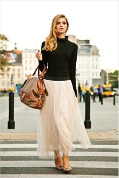turtleneck. ankle length skirt. flowy.