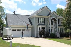 """""""After"""" photo of the roof installation in Franklin Chase subdivision in Cary, NC.  This was a great choice of shingle by the homeowner with a newly installed GAF Timberline HD in Pewter Gray."""