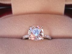 I love cushion cut rings. i love the shape, color, and size of this one