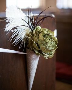 These would look great on the pews! Just switch out the green flower for one that is peach/champagne!!
