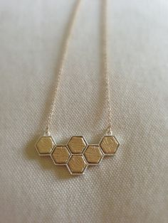 Honey Comb Hexagon Necklace by stitchandstonedesign on Etsy, $22.00