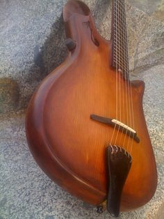short-scale archtop guitar... interesting upper horn soundhole