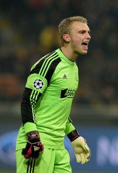 Jasper Cillessen Photos - Jasper Cillessen of Ajax Amsterdam reacts during the UEFA Champions League Group H match between AC Milan and Ajax Amsterdam at Stadio Giuseppe Meazza on December 2013 in Milan, Italy. - AC Milan v Ajax Amsterdam Kelly Brook Pics, Daley Blind, Afc Ajax, Amsterdam, Ac Milan, Uefa Champions League, Goalkeeper, Football Shirts