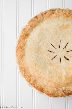 This is a tender, flaky, melt-in-your-mouth pie crust that is made with just 4 ingredients. It is unbelievably easy to make and works well with both sweet a
