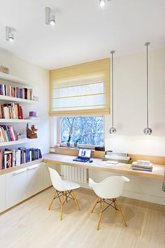 Ideal layout for future study room. Hanging lights and blinds over the windows plus bright spotlights help to illuminate the room and make it conducive for studying/working.