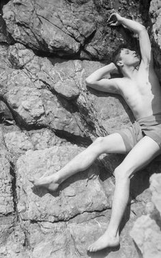 Rex Whistler (1905-1944, British) by Cecil Beaton in 1927 on the rocks at Cap Ferrat-South of France.