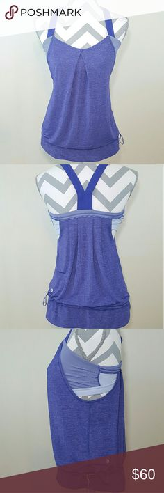 Lululemon Run Back On Track Tank Worn a couple of times, in good condition. Tank has draw strings at the bottom, so has the option of a cinched look (pictured) or can be worn flowy. lululemon athletica Tops Tank Tops