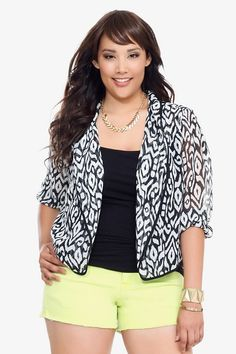 A bold black and white ikat print adds trend-right pattern to this sheer chiffon blazer. Slip on this lightweight third piece to easily polish your day or night summer looks.