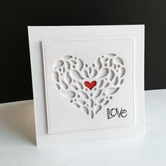 """die cut and layered underneath the top panel two layers of the corbel die, then die cut a red heart and put into the corbel dies. """"Love"""" is  from the Love & Quotes sentiment stamp set."""