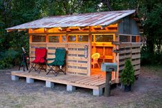 Pallet Playhouse my husband built with my dad for our daughter...so cute that we also use it to camp in! ❤️ Made from recycled pallets and tin! #pallets #play