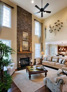 33 Lovely Family Room Interior Design Ideas With Fireplace To Have - Inside your home, the living room is the busiest area. This is where your family and friends spend a lot of time, so you want to create a very comfort. Home Living Room, Living Room Designs, Living Room Decor, High Ceiling Living Room, Living Area, Patio Interior, Interior Design, Room Interior, Tall Fireplace