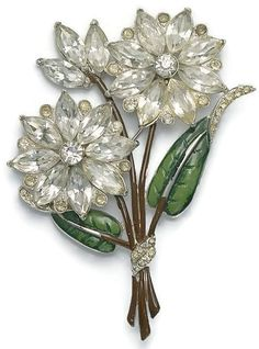 The pin is marked CORO.  I believe it dates to the 1940's The petals are navette shaped rhinestones.  The center is a clear rhinestone chaton.