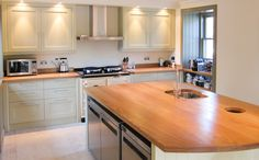 Bespoke painted kitchen with solid oak worktops.