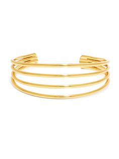 Gold loops lend a minimal touch to this stacking bracelet. Cuff is not adjustable.