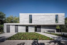 Contemporary Residential House Cologne Hahnwaldnatural covered in gray quartzite matte stone - CAANdesign | Architecture and home design blog
